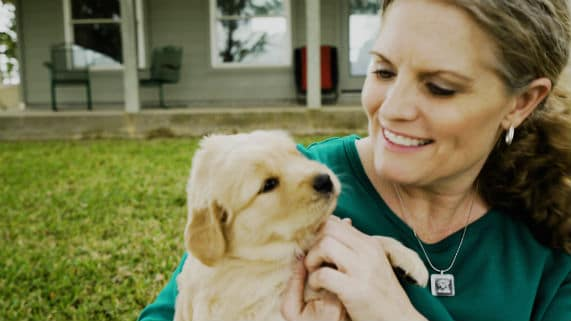 Kim Pruitt and her new puppy, Story